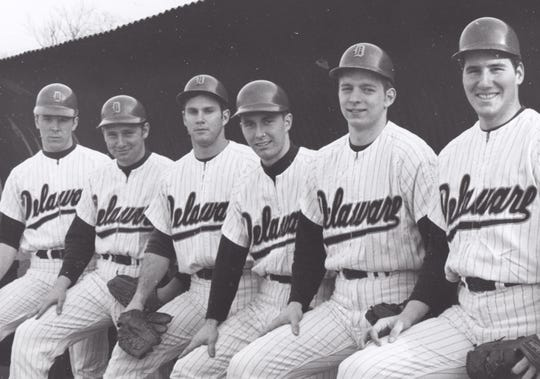 Members of Delaware's 1970 team gather on the dugout steps.