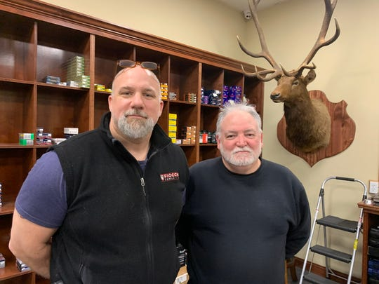 First State Firearms & Accessories's Larry Hudson (left) and Lane Carey have seen their shelves empty fast.