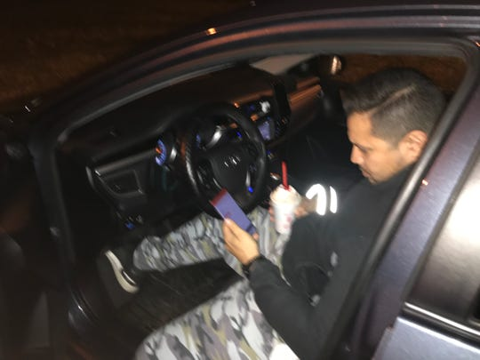 DoorDash driver Marco Valera checking the location where he has to take his delivery.