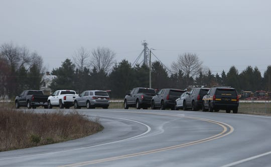 Vehicles line Middetown Warwick Rd. after a man barricaded himself inside a home.
