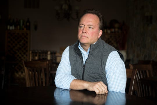 "Redfire Grill owner Carl Georigi sits for a portrait in his restaurant Tuesday morning. Georigi was forced to lay off almost 400 people across his six restaurants after Gov. John Carney announced a ban on dine-in services at restaurants and bars Monday. ""I'm just devastated for these people,"" said Georigi. ""I had no choice."""
