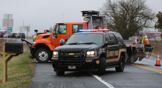 Police and DelDOT vehicles closed off numerous roads in the Middletown area Tuesday morning after a man barricaded himself inside a home.