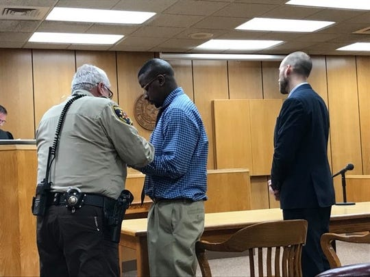Convicted murderer Jermar Jamie Fuller is handcuffed before being led from the courtroom Monday evening.