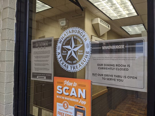 Signs on the door of Whataburger Tuesday, March 17, 2020, gave notice to customers that the dining room was closed to help stop the spread of COVID-19. Orders can still be fulflled by going through the drive-thru.
