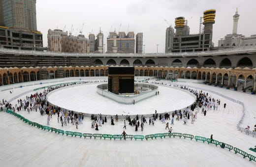 Muslim worshippers circle the sacred Kaaba in Mecca's Grand Mosque, Islam's holiest site, on March 13, 2020.