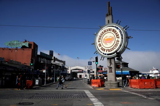 Few people are seen at San Francisco's popular Fisherman's Wharf tourist destination on March 12, 2020 in San Francisco, Calif.