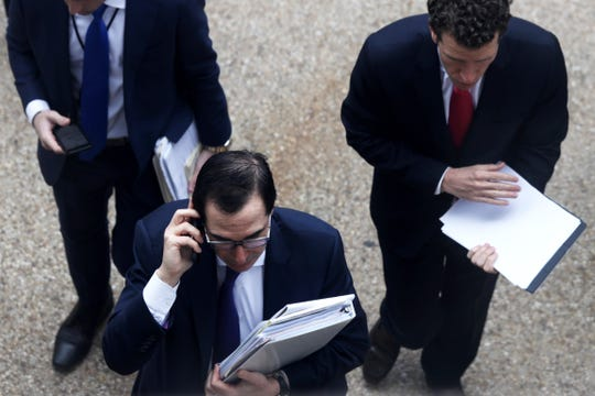 Secretary of the Treasury Steven Mnuchin arrives on Capitol Hill to attend the weekly Senate Republican policy luncheon on March 17, 2020.