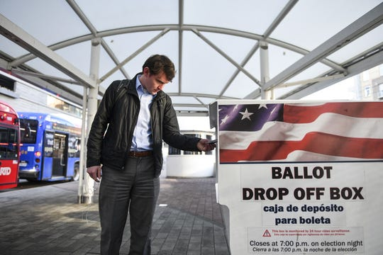 A voter drops off his ballot in Denver on March 3, 2020.