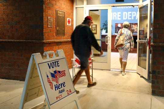 Voters walk into a polling station for the Florida presidential primary, March 17, 2020, in Bonita Springs, Fla.