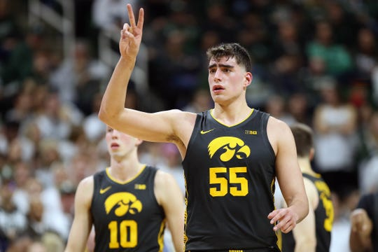 Iowa Hawkeyes center Luka Garza (55) gestures during the second half a game against the Iowa Hawkeyes at the Breslin Center.