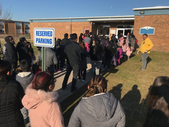 More than 100 Lakewood public schools parents stood in line and bunched together early Wednesday outside the Board of Education buildingas they picked up education packets, Chromebooksand meals — part of the school district's remote-learning contingencies.