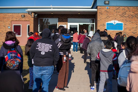 Lakewood public schools parents and students stood in line waiting to get education packets, Chromebooksand meals during the second day of emergency measures to prevent the spread of the coronavirus.