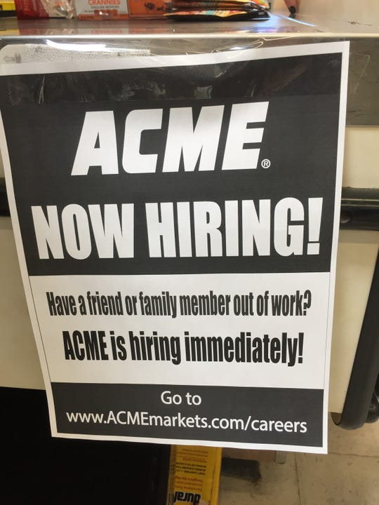 A sign hanging in the Acme in Freehold Township indicates the supermarket is hiring. Wednesday, March 19, 2020.