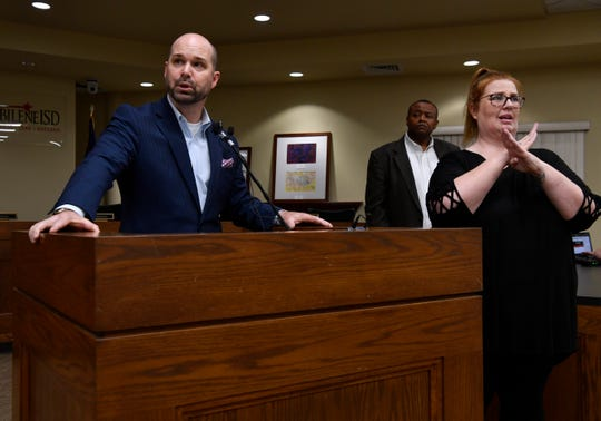 0319covidpresser1 Brad Holland, president and CEO of Hendrick Health System, answers questions at the end of Wednesday's joint news conference between city and school district officials. Behind him is Mayor Anthony Williams and Paula Boyle, a translator for the deaf.