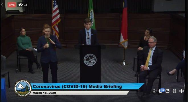 Buncombe Public Health emergency preparedness coordinator Fletcher Tove speaks during a March 18 media briefing broadcast on Facebook Live.