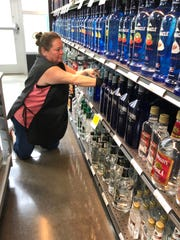 Kimberly Alfieri Watson stocks shelves at the Arden ABC store on Wednesday, March 18, 2020. Watson said sales have been unusually strong in recent days.