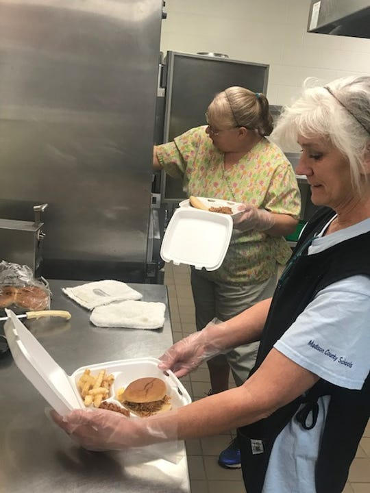 Nutrition workers Kristina Diemer and Roxanne English package lunch for pickup March 16. Meals are now being delivered to students and their families across Madison County.