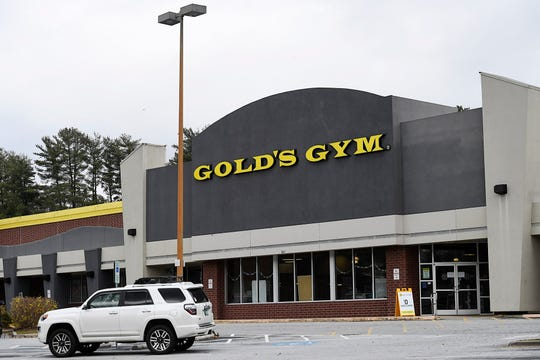 A sign in front of Gold's Gym advertised free enrollment March 18, 2020.