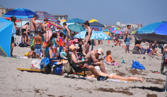 Brevard County is seeking to take steps to reduce large gatherings at beaches without having to close popular beaches like this one at Lori Wilson Park in Cocoa Beach