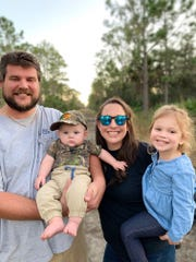 Justin Rogers and Brooke Klein, with their children Noah and Sadie, have had to postpone their March 22 wedding.