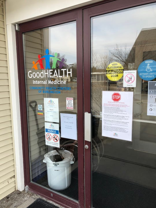 Signs on the door of Good Health, Community Health Centers of Burlington, in South Burlington, lays down the rule in effect during the COVID-19 outbreak on Wednesday, March 18, 2020. The procedures include taking the temperature of visitors and patients before allowing them to pass through the door.