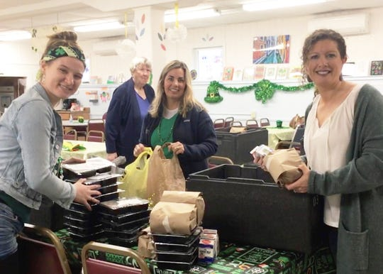 Staff members and volunteers at Heineberg Community Senior Center in Burlington set up pre-packaged meals to sent out to seniors on March 17, 2020. Each year they celebrate St. Patrick's Day with a luncheon that brings up to a 100 seniors from around the area, but this year, they were unable to celebrate at the senior center.