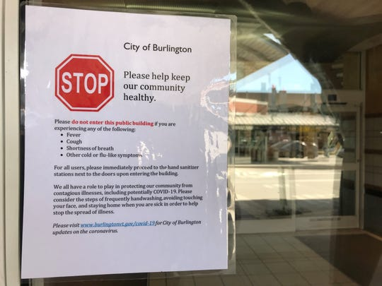 Burlington International Airport posted signs urging people not to enter the terminal if they were experiencing a fever, cough, shortness of breath or other flu-like symptoms.