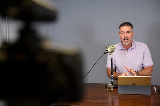 "First Baptist Church's Pastor Brian Hill records an online bible study, Wednesday, March 18, 2020. ""Even though we can't meet physcially, we can still connect,"" Hills says."
