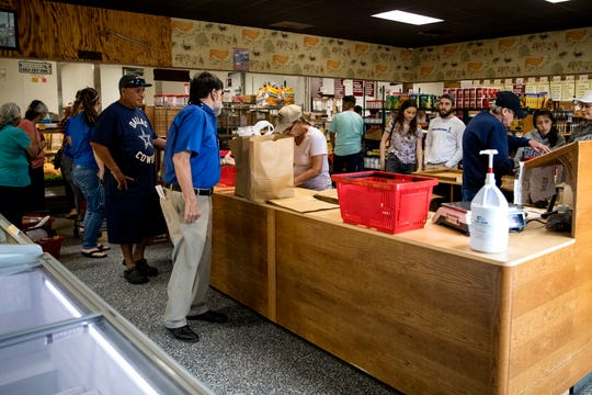 """Moody's Quality Meats had a steady stream of customers on Wednesday, March 18, 2020. Owner Terry Moench said that there is plenty of food and if people act responsibly there will be enough for everyone. """"This is the land of plenty, it's still here,"""" he said."""