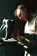 John Seward Johnson Jr., with the maquette of 'The Tooth.'
