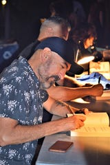Author and Rutgers professor Paul Lisicky signs copies of 'The Narrow Door,' at Tin House in Brooklyn in 2017.