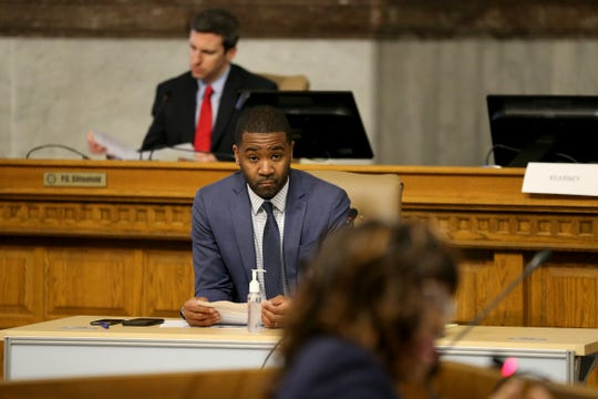 Cincinnati City Manager Patrick Duhaney listens to Health Commissioner Melba Moore address city council, Wednesday, March 18, 2020, at City Hall in Cincinnati.
