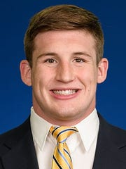 Michigan heavyweight wrestler Mason Parris is from Lawrenceburg, Indiana