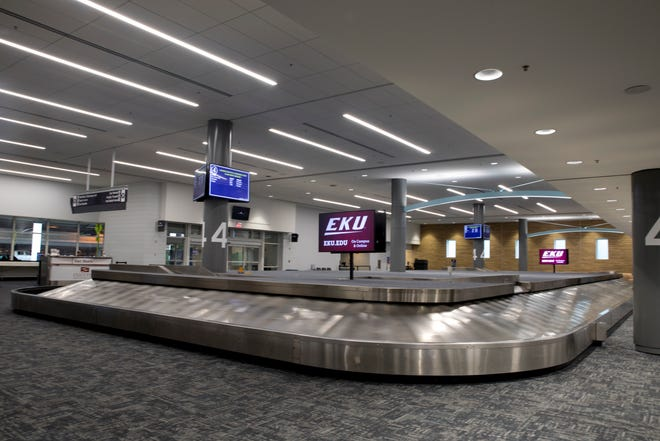 A baggage claim belt runs at Cincinnati/Northern Kentucky International Airport on Wednesday, March 18, 2020, in Hebron, Ky.