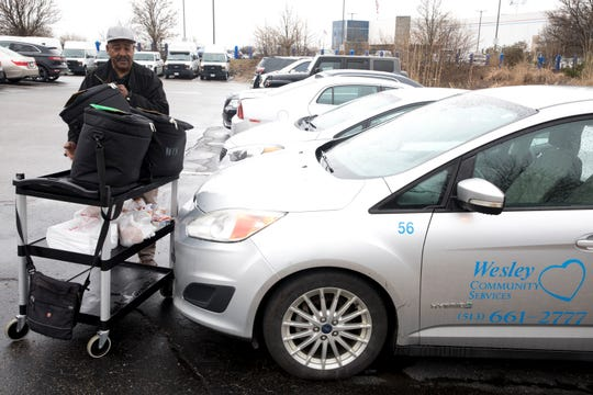 Ron Tilford, a Meals on Wheels driver, loads his vehicle with food from Meals on Wheels of Southwest Ohio and Northern Kentucky in Lower Price Hill for deliveries to seniors Wednesday morning.