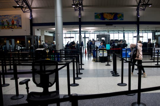 A traveler approaches the the security desk at Cincinnati/Northern Kentucky International Airport on Wednesday, March 18, 2020, in Hebron, Ky.
