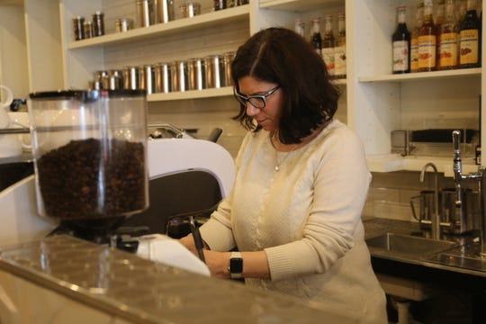 Yada on Franklin owner Darla Knight prepares a latte behind the bar of her downtown Clarksville restaurant on March 17, 2020, as she works to reinvent her business model to survive the coronavirus crisis.