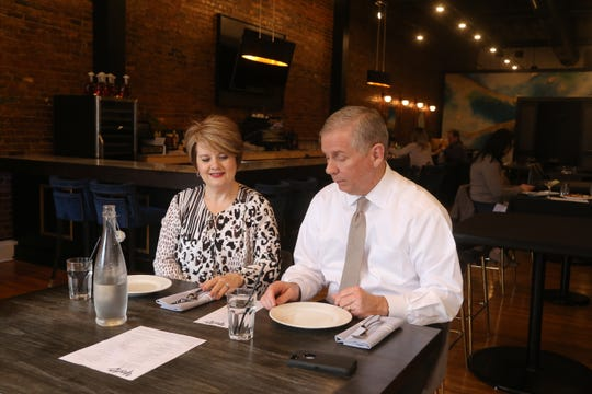 Clarksville Mayor Joe Pitts and his wife Cynthia dine in the mostly empty Yada on Franklin restaurant in downtown Clarksville on March 17, 2020, saying it's important to remain optimistic despite the ever-changing situation with the coronavirus outbreak.
