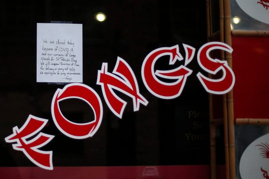 A sign on the window of Fong's Pizza in Des Moines states that the restaurant is closed for the evening due to Covid-19 and their concern about large crowds. All bars and restaurants in the Court Avenue district were closed in order to keep large groups of people from gathering on St. Patrick's Day in Des Moines on Tuesday, March 17, 2020.