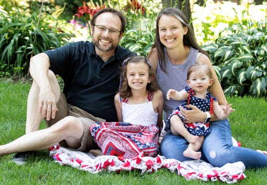 Michael Klesper, 51, of Kalamazoo, with his wife Stephanie, 37, and daughters Natalie, 7, and Megan, 1.