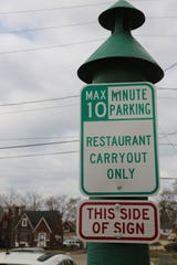 A restaurant carryout parking sign outside Table No. 2 in northwest Detroit Tuesday, March 17, 2020.