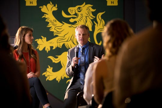 Tim Gibson, the president of The King's College in New York City, talks with students in this undated photo.
