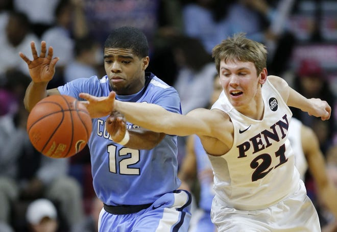 Penn's Ryan Betley, right, reaches for a loose ball against Columbia's Mike Smith during the second half at The Palestra in Philadelphia on Friday, Feb. 10, 2017. Penn won, 70-62.