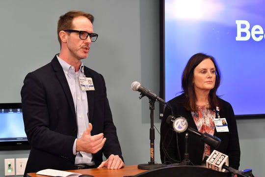 From left, Dr. Nick Gilpin and Beaumont Health Chief Nursing Officer Susan Grant hold a press conference at be Beaumont Service Center in Southfield, Mich. on Wednesday, March, 18, 2020.  This was the announcement of the first death of a patient with COVID-19 in Michigan.
