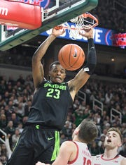 A strong junior season and a growing family might be enough to push Michigan State center Xavier Tillman to the NBA.