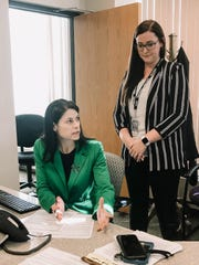 Attorney General Dana Nessel answers consumer complaint calls related to COVID-19 price-gouging and scams on Tuesday, March 17, 2020.