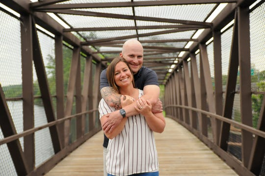 Lorrie Chaperon, 31, and her fiance Matthew Osborne, 31, pose for their engagement. Chaperon and Osborne were supposed to be married at a venue on March 28 but the venue canceled due to concerns of coronavirus.