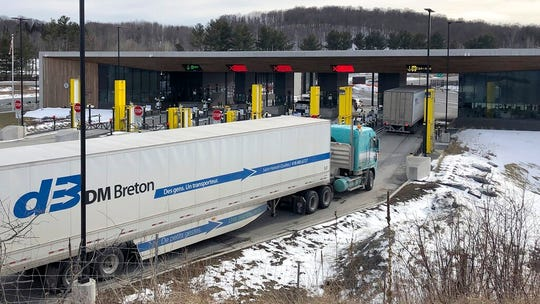 "A truck traffic from Canada waits to cross the border into the United States, Wednesday, March 18, 2020, in Derby Line Vt. The Canada-U.S. border will be closed to non-essential traffic in both directions ""by mutual consent,"" the leaders of both countries confirmed Wednesday as efforts across the continent to contain COVID-19."