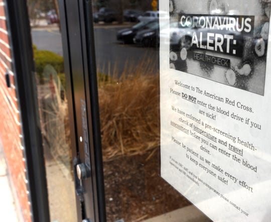 Coronavirus Alerts are displayed on the front door of the American Red Cross' Bloomfield Donation Center in Bloomfield Twp.