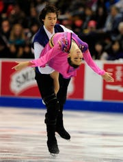 Japan's Cathy Reed and Chris Reed skate for a fifth place finish during the free dance program at the Hilton HHonors Skate America 2013 at Joe Louis Arena in Detroit, Michigan on October 19, 2013.